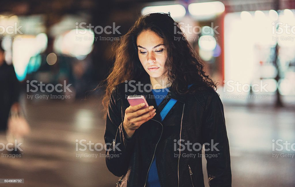 Texting outside at night stock photo