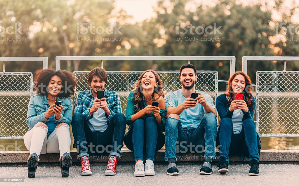 Texting separately outdoor stock photo