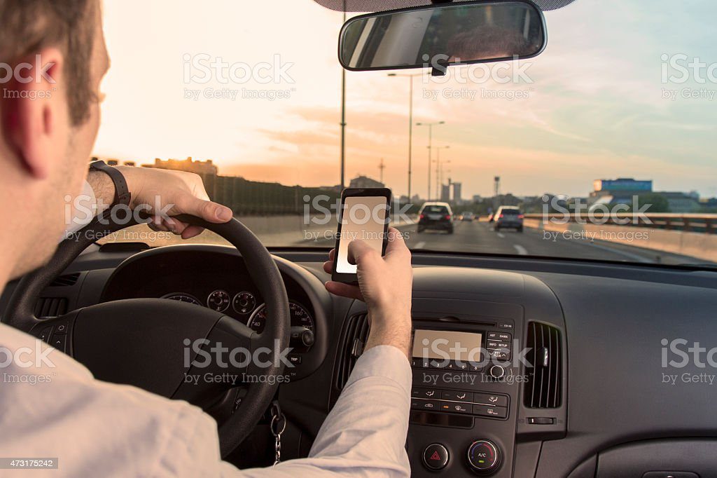 Texting sms while driving stock photo