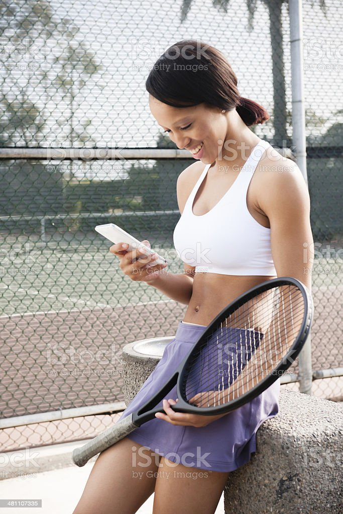 Texting Tennis Player stock photo