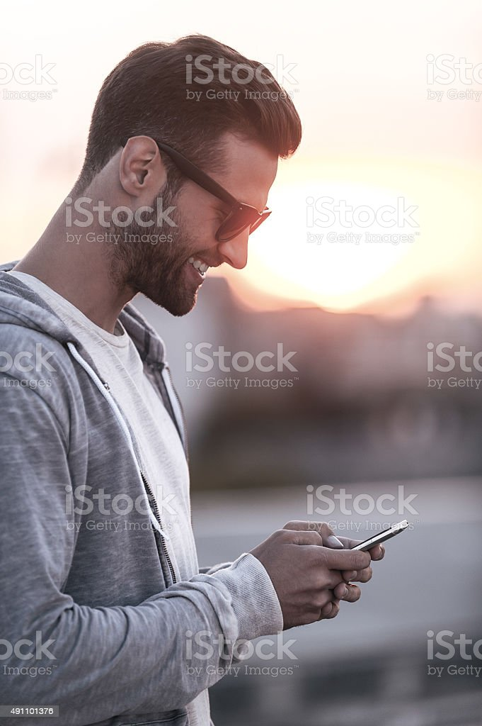 Texting to friend. stock photo