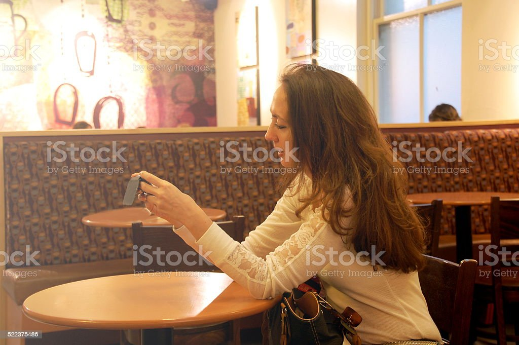 Texting to loved ones stock photo