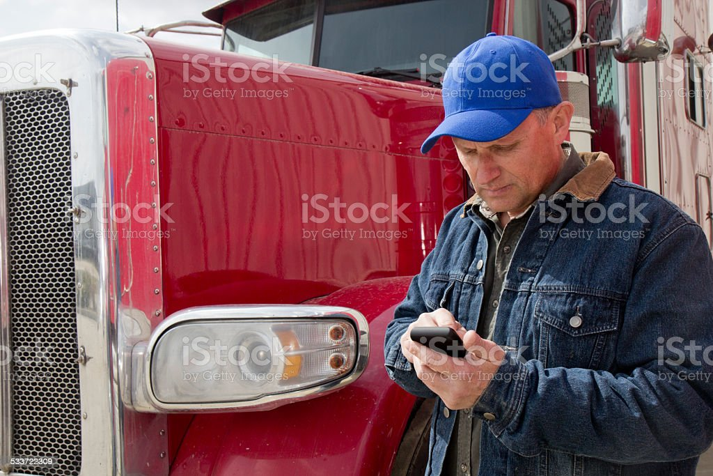 Texting Truck Driver stock photo
