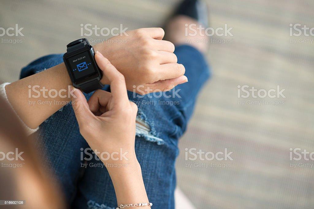 Texting via smart watch stock photo