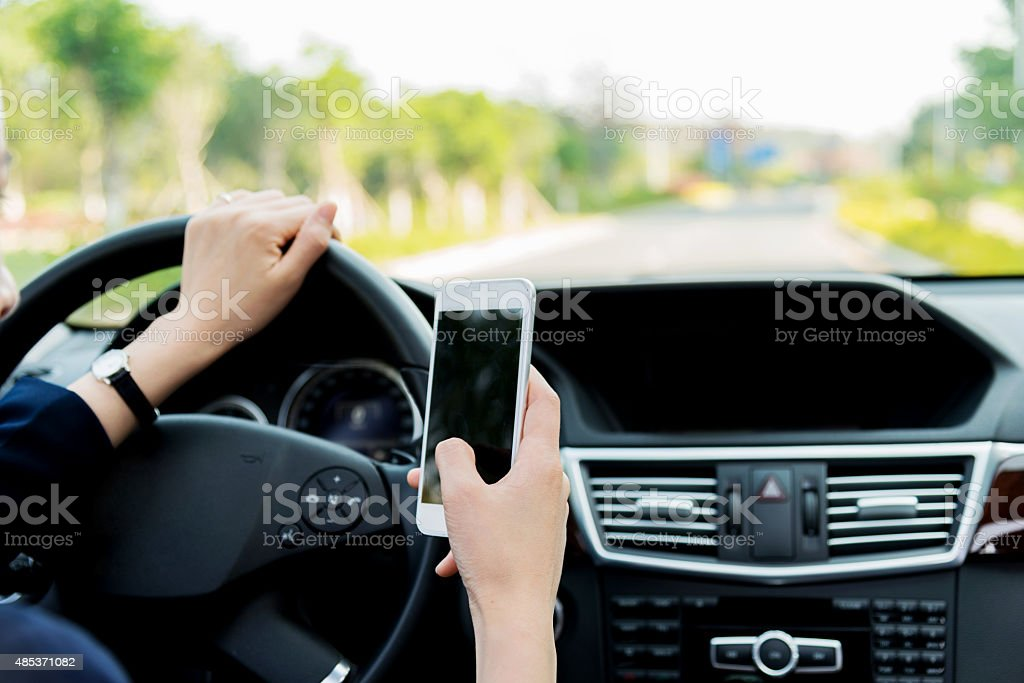 texting while driving stock photo