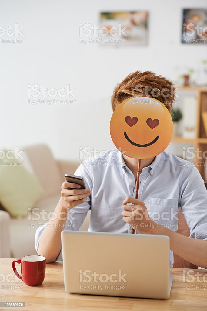 Texting with girlfriend stock photo