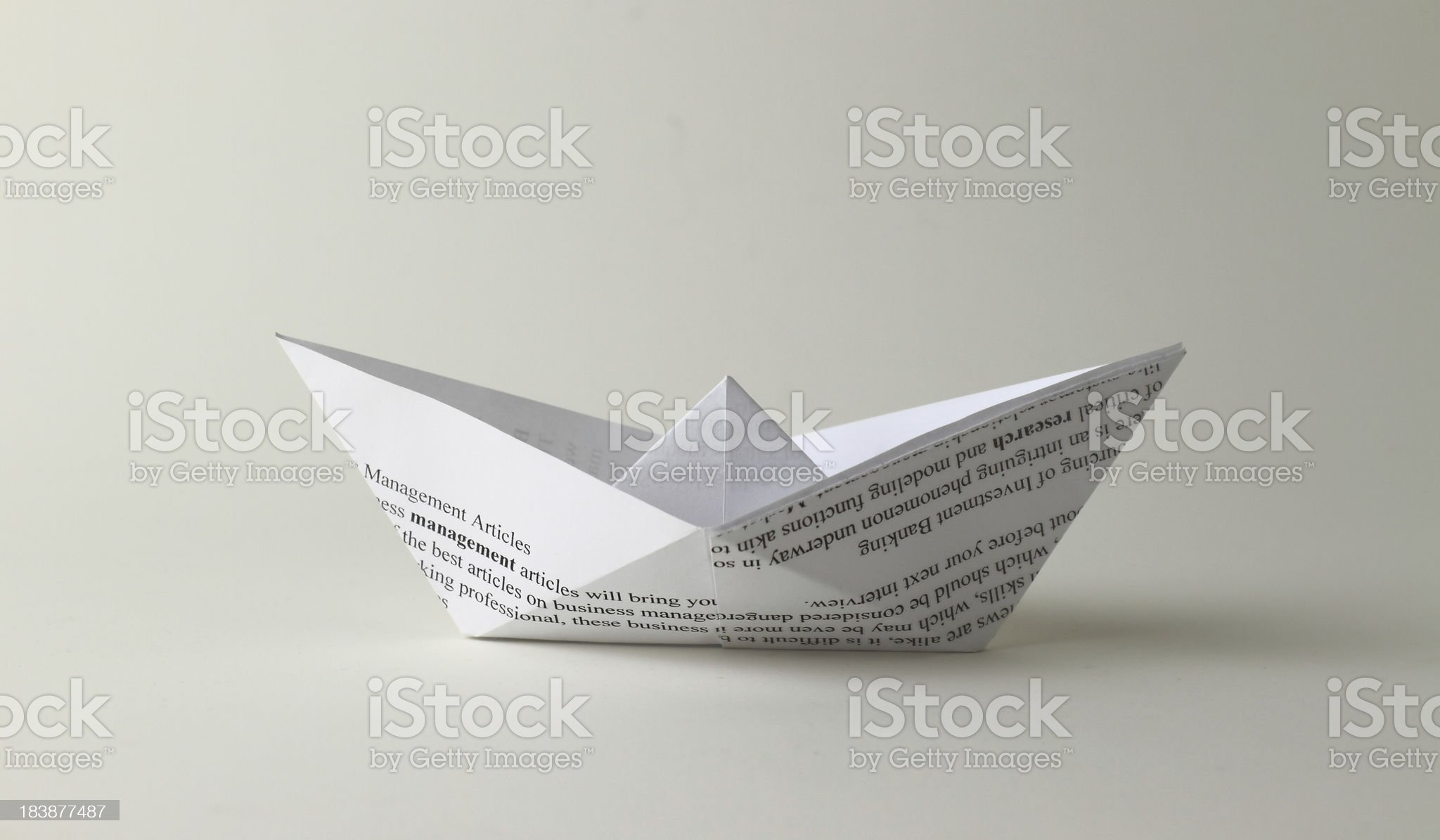 Texts on the origami ship royalty-free stock photo