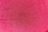 Texture, background of bright red silk fabric corded