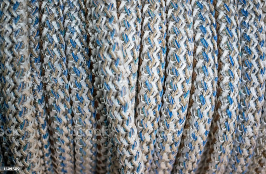 Texture braided rope white and blue colors. Background. stock photo