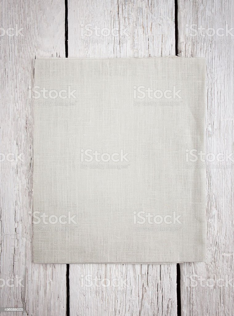 Texture canvas fabric on wooden background stock photo