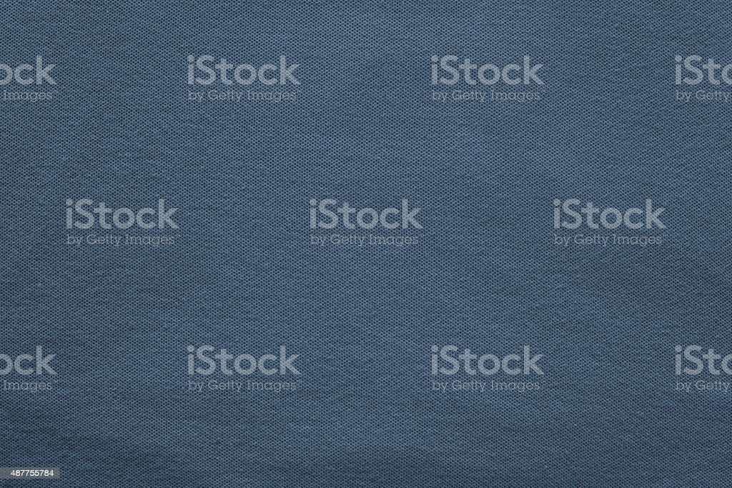 texture knitted fabric of dark blue color stock photo