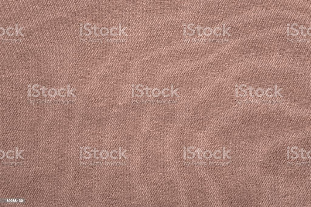 texture knitted fabric of dirty pink color stock photo