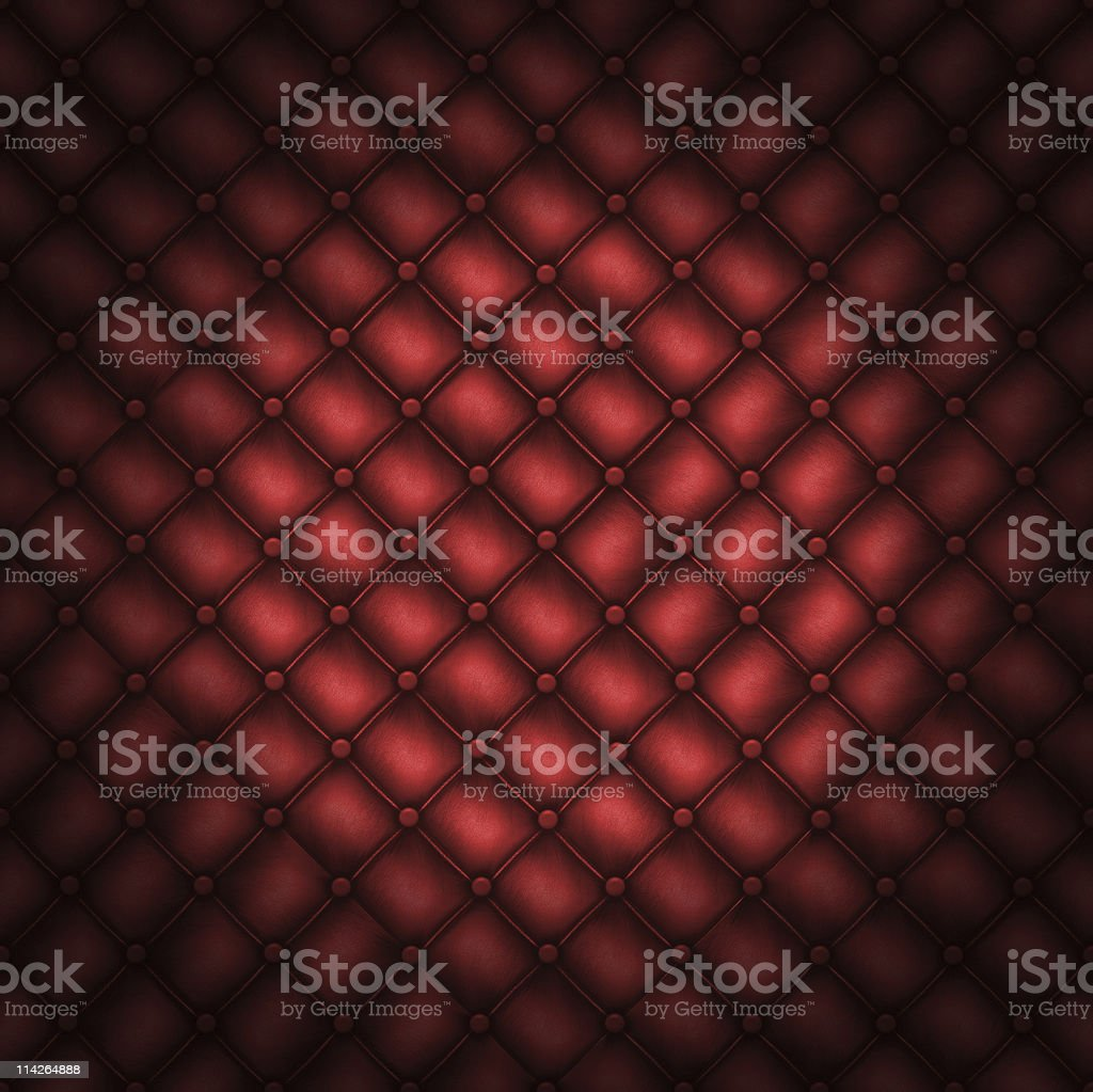 Texture leather quilted a sofa. Red color royalty-free stock photo