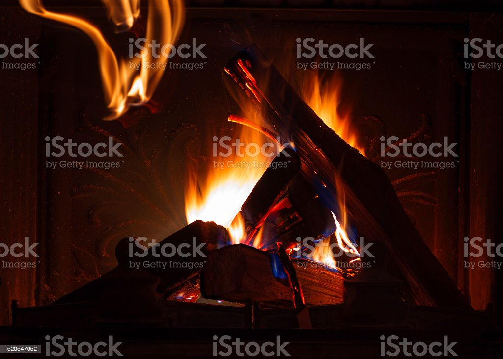 Texture of a blazing fire in the fireplace. stock photo
