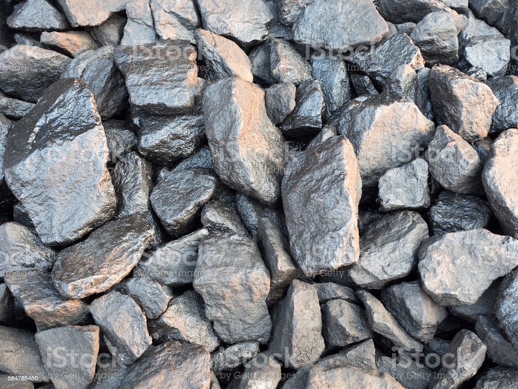 Texture of a gravel with black oil stain stock photo