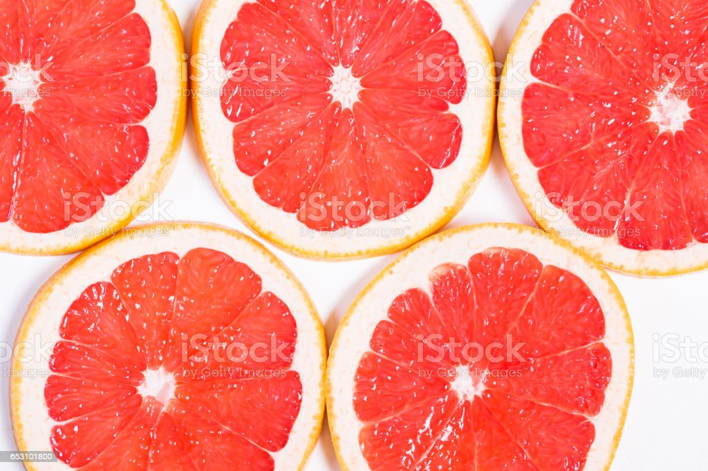 Texture of a ripe grapefruit slice, closeup stock photo