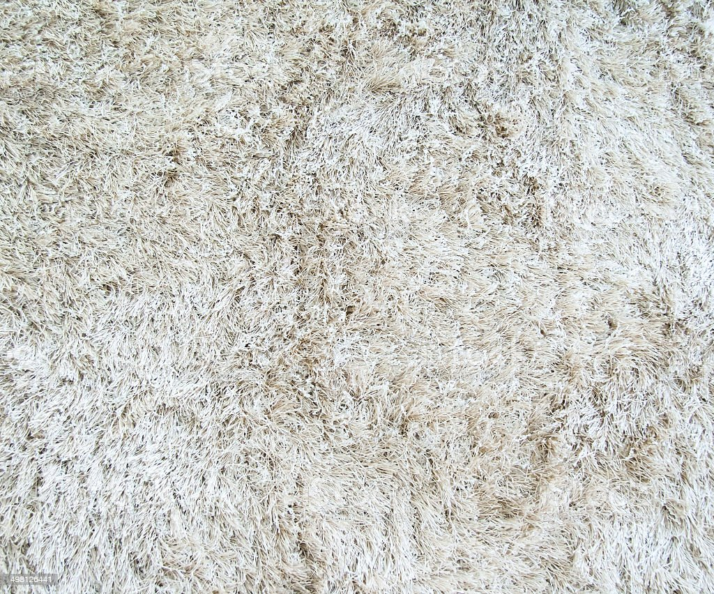 texture of a white carpet with long pile stock photo