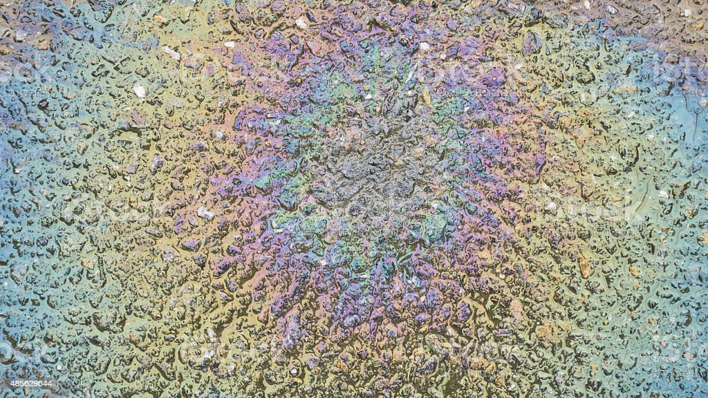 Texture of an oil spill on asphalt road stock photo