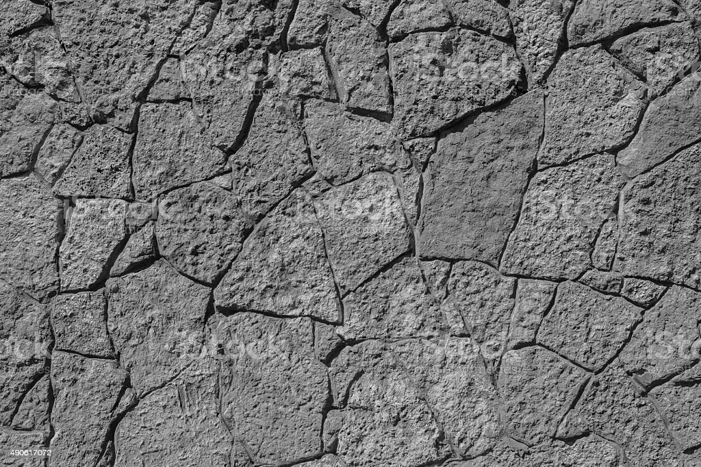 texture of black color stone wall with cracks stock photo
