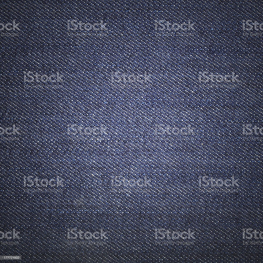 Texture of blue jeans textile close up royalty-free stock photo