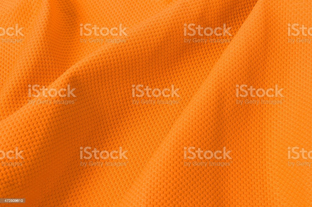 texture of bright, acid orange cloth with pleat stock photo