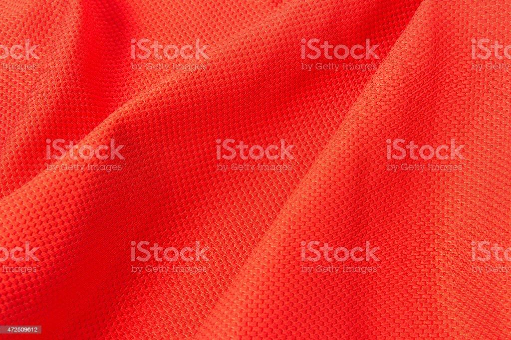 Texture of bright, acid rad cloth with pleats stock photo