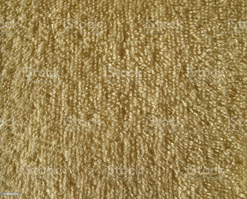 Texture of brown terry cloth fabric stock photo