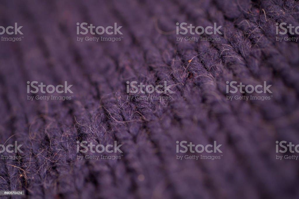 Texture of dark blue knitted woolen fabric stock photo
