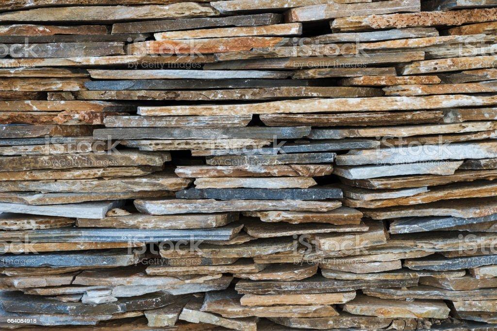 Texture of decorative flat stones wall stock photo