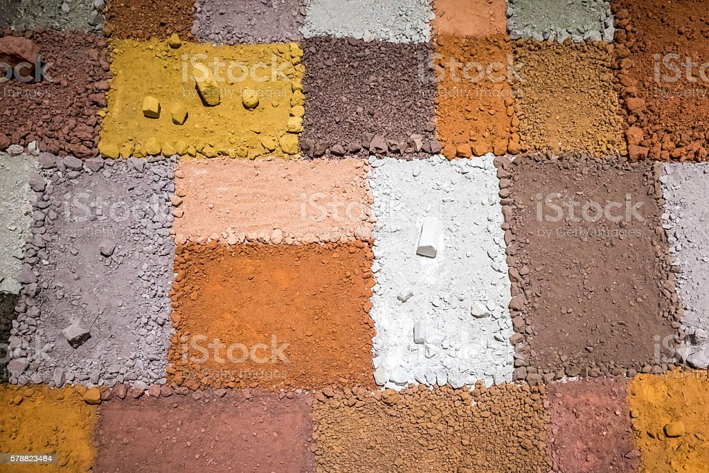 Texture of different colors of dry clay with stones stock photo