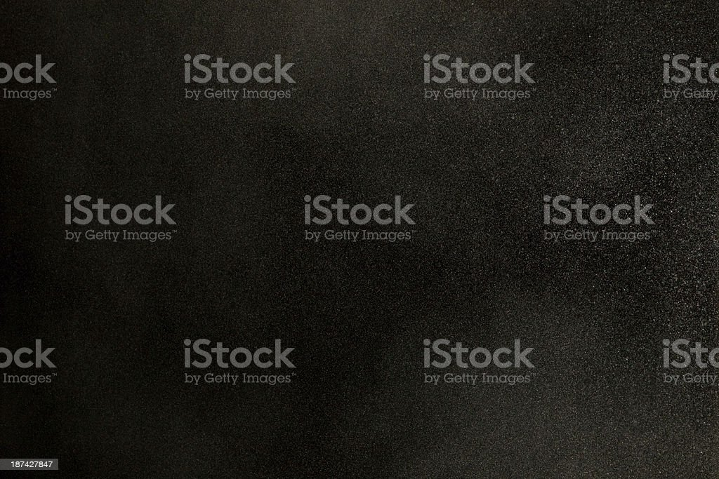 Texture of dust in the wind over black background stock photo