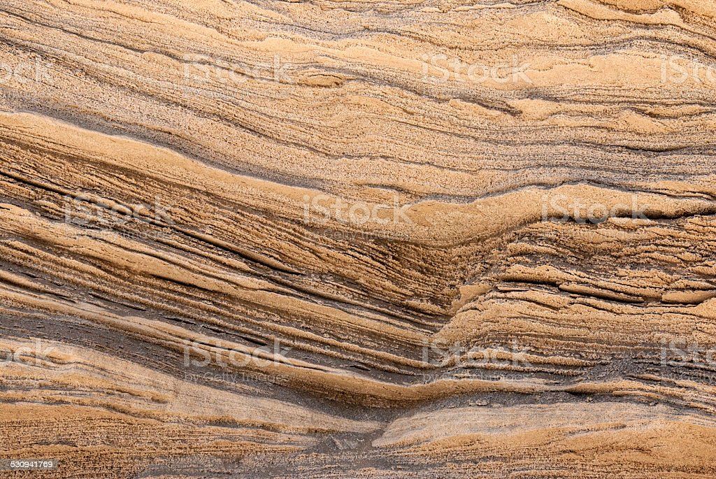 texture of golden lines of loose rock stock photo