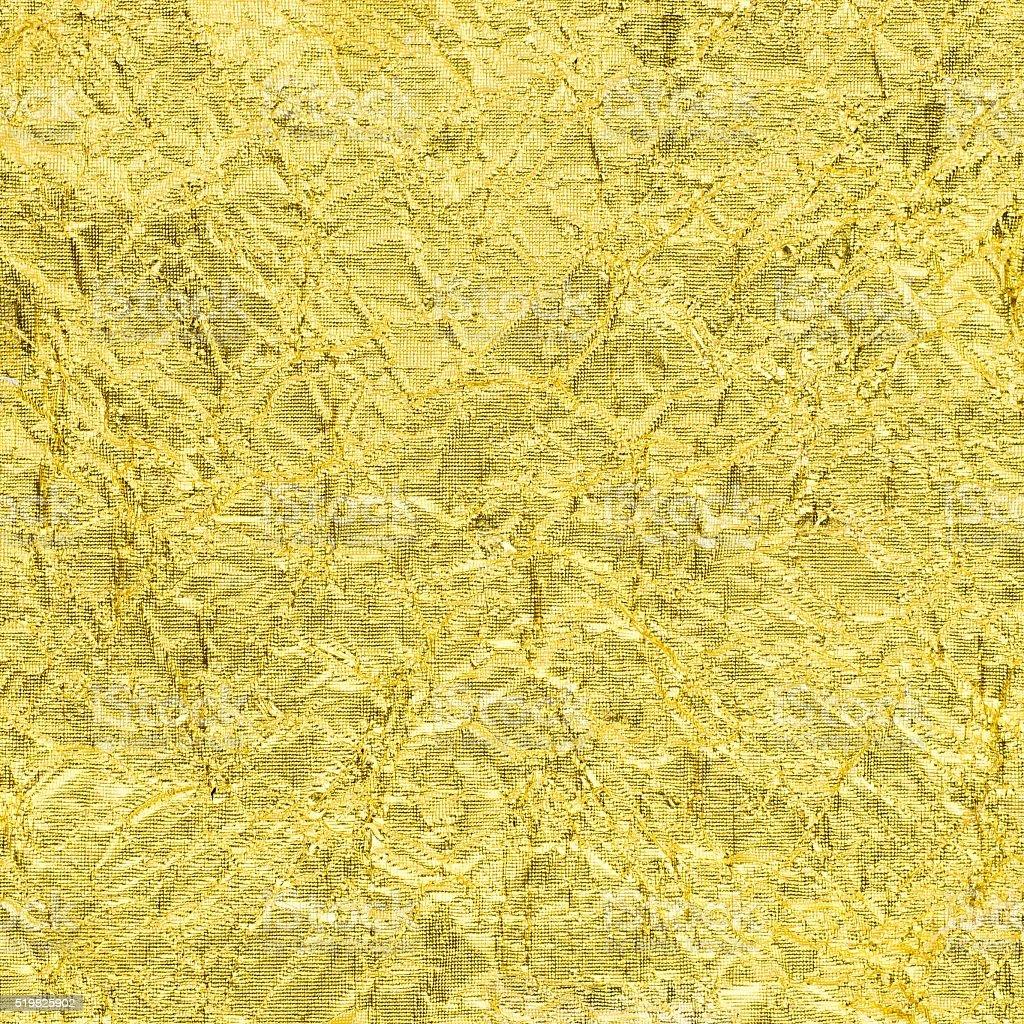 texture of golden rumpled stock photo