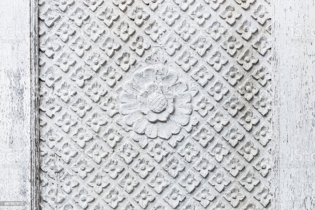 Texture of handmade carving white wooden wall in Bali house. Traditional indonesian style stock photo