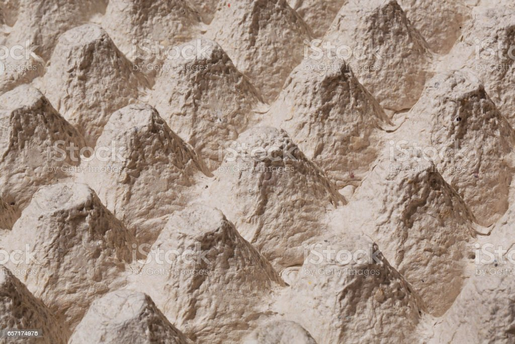Texture of mountains in the close-up picture of cardboard tray for eggs. stock photo