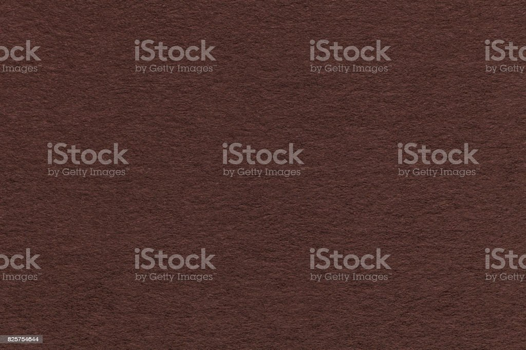 Texture of old brown paper closeup. Structure of a dense cardboard. The background. stock photo