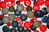 texture of red, black, gray buttons on white background