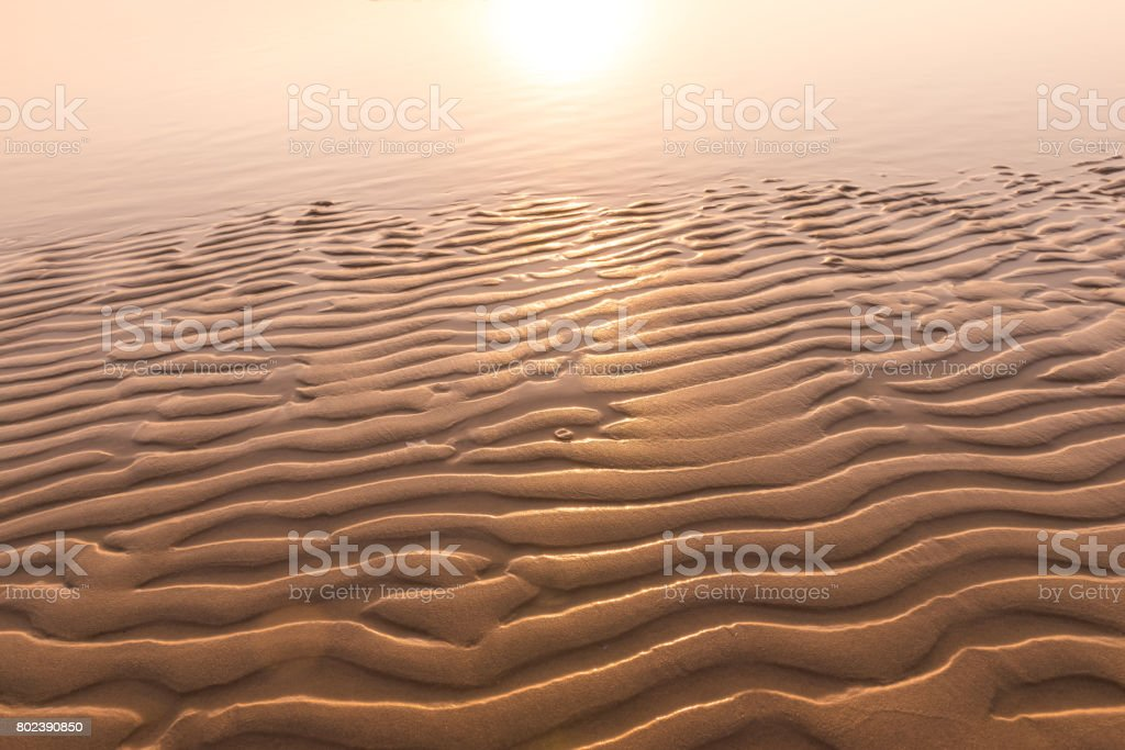 Texture of sand wave, lighting from sunset stock photo