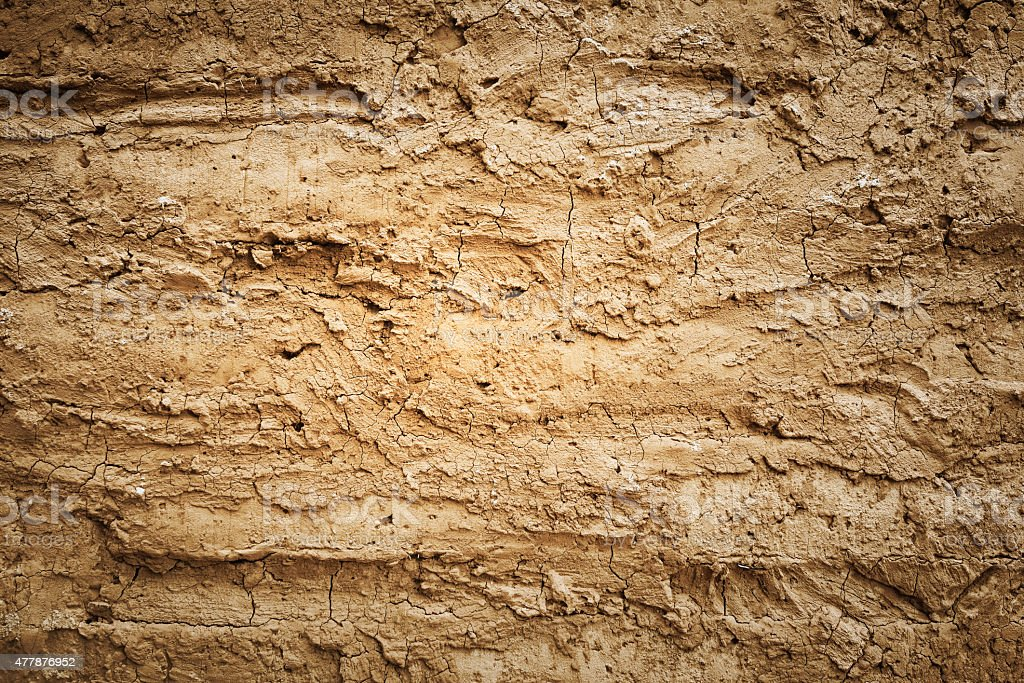 Texture of soil wall of traditional house stock photo