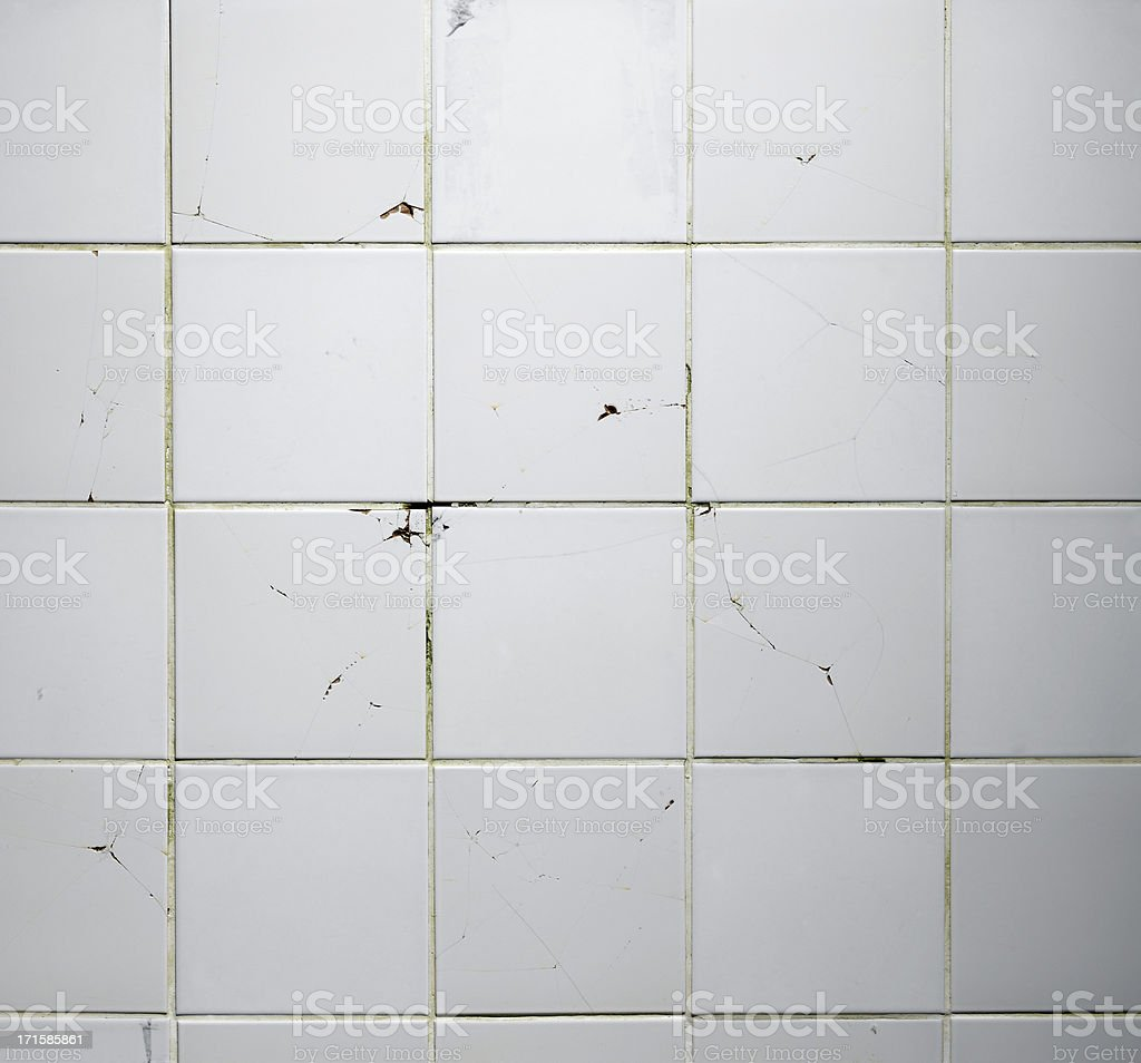 Texture of the old tile wall with cracks stock photo