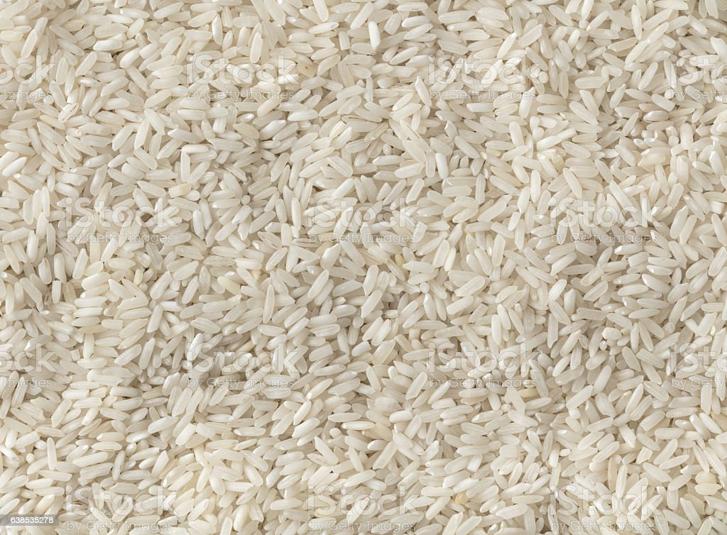 texture of uncooked rice closeup stock photo