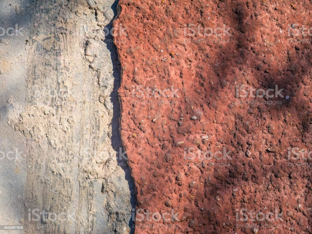 Texture of wall with a piece of plaster was taken stock photo