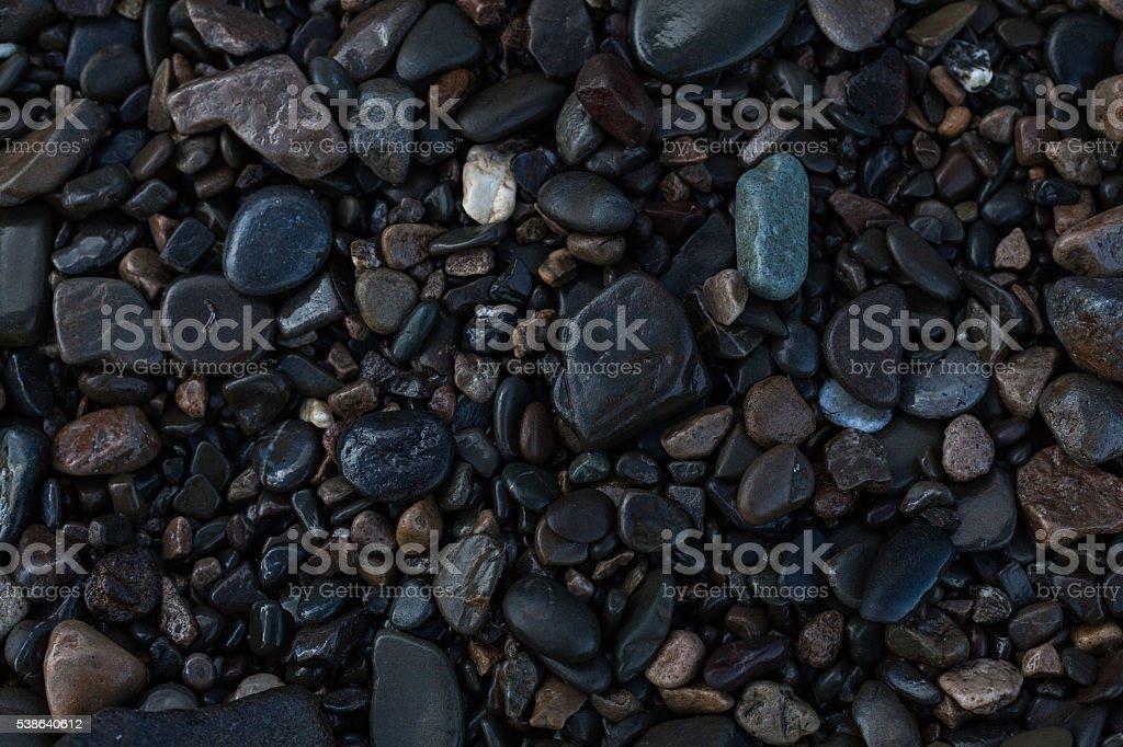 texture of wet shiny small sea stones stock photo