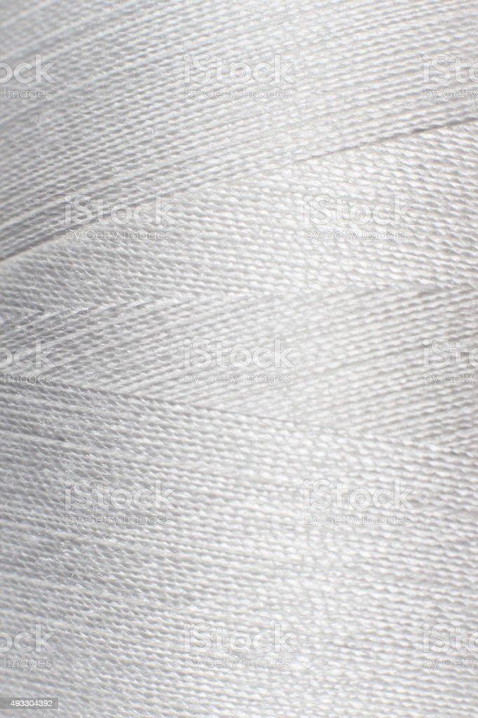 texture of white thread in spool stock photo