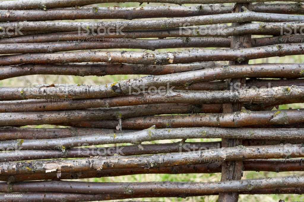 Texture of wicker fence, natural brown background stock photo