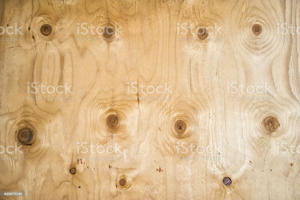 Texture of wood surface with nodules stock photo