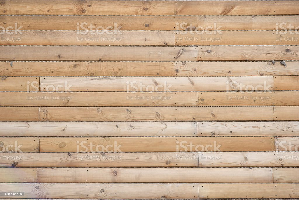 Texture of wooden wall (long logs) royalty-free stock photo