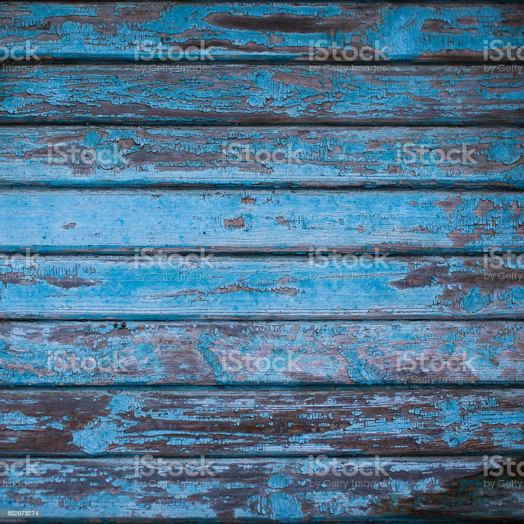 texture of wooden wall with shabby navy blue paint stock photo