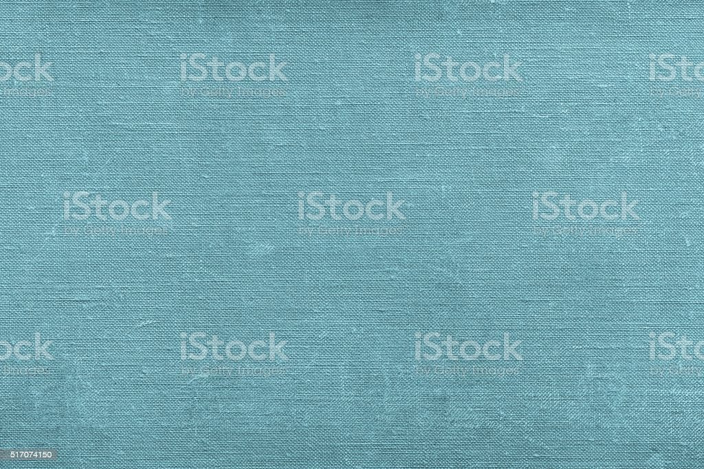texture rough textile material of blue green color with attritions stock photo