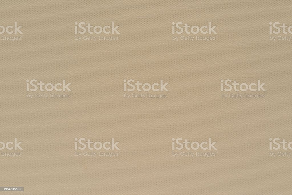 texture speckled fabric or paper material of pale beige color stock photo